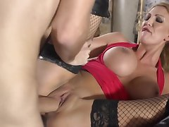 Full-bosomed MILF in red top with an increment of fishnets fucked by massive cock