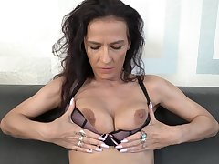 Horny solo mature spreads her legs together with inserts a dildo in her cunt