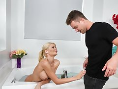 Aroused blonde MILF pleases stepson in bed