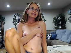 Cute saggy boobs granny on the top of cam