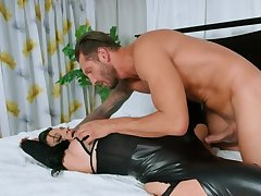 Brunette in coloured outfit pussy-fucked by lover in the bedroom