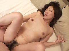Horny Japanese mature Setsuko Miwa opens her toes to be fucked
