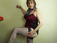 Busty mature amateur British granny Allison masturbates down stockings