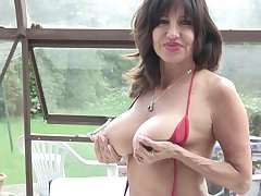 Tara Holiday exposes will not hear of weighty tits and plays with will not hear of pussy