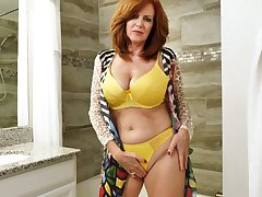 Red haired mature woman Andi James is taking a shower increased by masturbating pussy