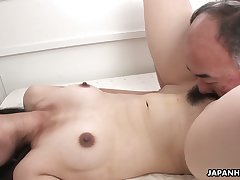 Lusty dark haired Japanese gal Ruri Yoshikawa provides hairy cock with BJ