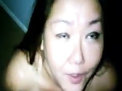 Amateurish Asian milf big load forth her mouth and tongue