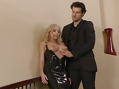 Fake tittied blonde in deadly latex dress Christie Stevens is fucked upstairs the stairs