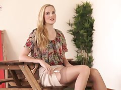 Decidedly leggy blonde slut Ariel Anderssen loves posing in her titillating underclothes