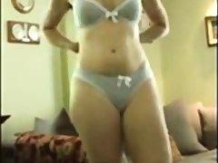 Woman strips off