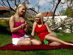 Endearing outdoors pussy licking action with sassy lesbian duo