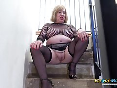 Age-old BBW cleans up her pee outsider the staircase after masturbating