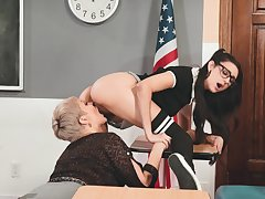 Lesbian teacher Ryan Keely is licking mouth-watering teen slit in 69 ambience pose