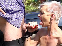 Short haired blonde in apple-polish with bumptious heels is sucking cock in a public place