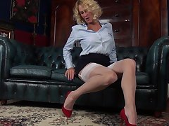 Amateur movie of cougar Molly Maracas playing on the fur sofa