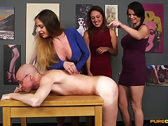 Clothed gals Cathy Heaven, Samantha Page and Tasha Holz stroke a stiffy