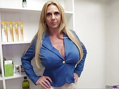 Hot mature jerks cock while flashing the heavy tits